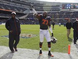 Chicago Bears defensive end Israel Idonije waves into the stands during warmups before the start of an NFL football game on October 28, 2013