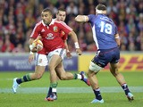 British and Irish Lions Simon Zebo runs past Mitch Inman of the Melbourne Rebels of Australia during their rugby match on June 25, 2013