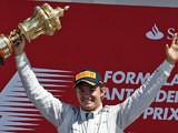 Nico Rosberg celebrates on the podium after winning the British Grand Prix at Silverstone on June 30, 2013