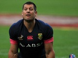South Africa's Pierre Spies stretches during a training session on June 7, 2013