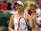 Germany's Sabine Lisicki celebrates defeating Russia's Elena Vesnina during day four of the Wimbledon Tennis Championships on June 27, 2013