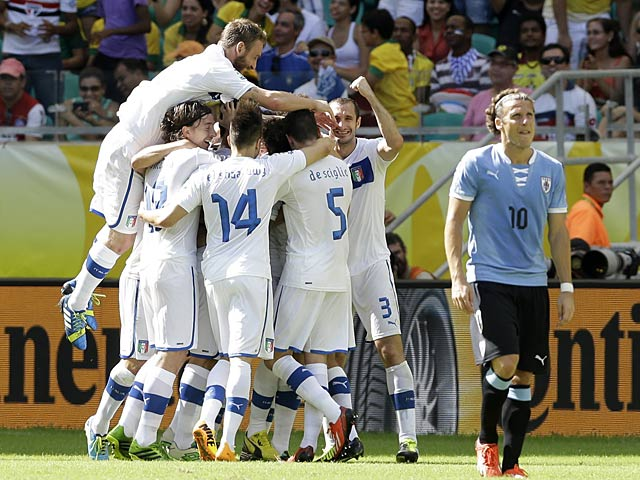 Italy's Davide Astori is mobbed by team mates after scoring the opening goal against Uruguay during their Confederations Cup match on June 30, 2013