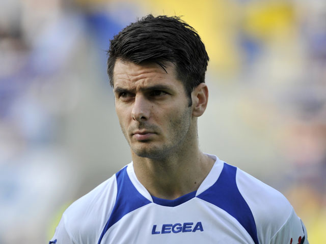 Bosnia's Emir Spahic stands during the playing of the national anthems before the start of World Cup 2014 Group G qualification match between Latvia and Bosnia on June 7, 2013