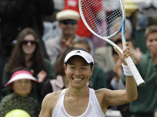 Kimiko Date-Krumm of Japan reacts after defeating Alexandra Cadantu of Romania during their Women's second round singles match on June 27, 2013