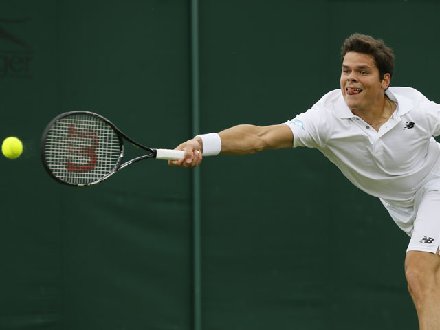 Milos Raonic of Canada plays a return to Carlos Berlocq of Argentina during their Men's first round singles match on June 25, 2013