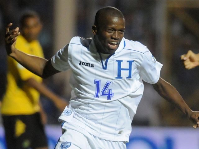 Honduras' Oscar Garcia celebrates after scoring against Jamaica during a 2014 World Cup qualifying soccer match on June 11, 2013
