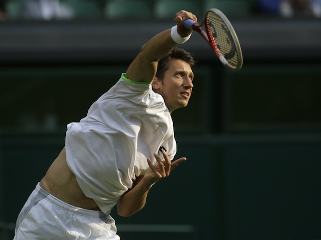 Sergiy Stakhovsky in action against Roger Federer on June 26, 2013
