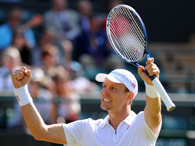 Czech Republic's Tomas Berdych celebrates defeating South Africa's Kevin Anderson during the Wimbledon Championships on June 29, 2013