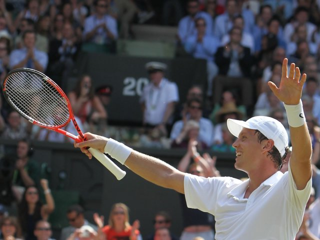 Tomas Berdych celebrates his win over Roger Federer at Wimbledon.