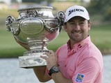 Graeme McDowell of Northern Ireland holds the trophy during the winning ceremony of the French Open Golf tournament on July 7, 2013