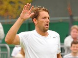 Poland's Lukasz Kubot celebrates defeating France's Adrian Mannarino after winning their match during day seven of the Wimbledon Tennis Championships on July 1, 2013