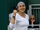 Marion Bartoli celebrates after beating Karin Knapp during their Wimbledon match on July 1, 2013