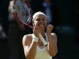Sabine Lisicki celebrates winning her Wimbledon semi-final against Agnieszka Radwanska on July 4, 2013