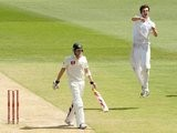 Steven Finn celebrates claiming the wicket of Michael Clarke during the 2010 Ashes.
