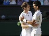 Andy Murray of Britain is congratulated by Novak Djokovic of Serbia after the Men's singles final match on July 7, 2013