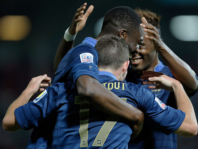 France's Jordan Veretout is congratulated by team mates moments after scoring his team's fourth goal against Turkey during the U20 World Cup on July 2, 2013