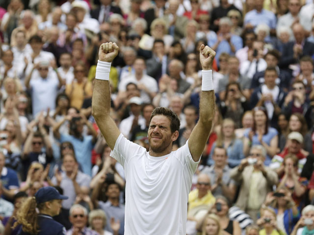 Juan Martin Del Potro of Argentina reacts after defeating David Ferrer of Spain in their Men's singles quarterfinal match on July 3, 2013