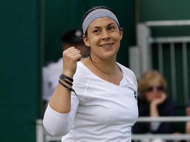 Marion Bartoli celebrates after beating Karin Knapp during their Wimbledon match on July 1, 2013