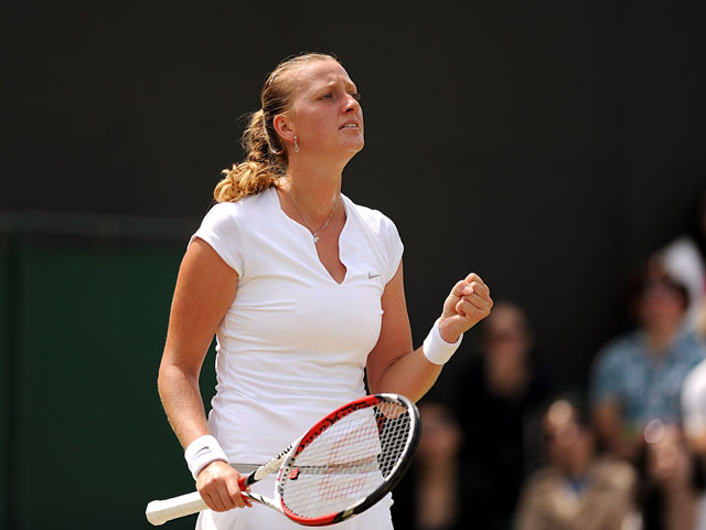 Czech Republic's Petra Kvitova in action against Spain's Carla Suarez Navarro during day seven of the Wimbledon Championships on July 2, 2013