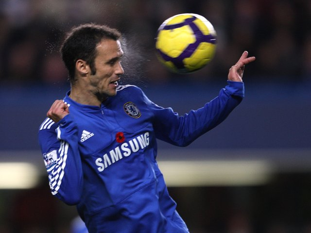 Defender Ricardo Carvalho heads clear the danger while playing for Chelsea.