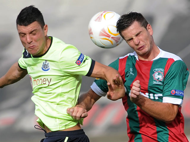 Maritimo's Valentin Roberge challenges for the ball with Newcastle's Haris Vuckic during a Europa League match on September 20, 2012