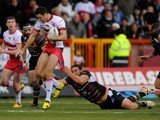 Catalan Dragons' Julian Bousquet tackles Hull KR's Craig Hall during a Super League match on February 3, 2013