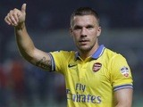 Arsenal's Lukas Podolski in action against an Indonesian XI on July 14, 2013