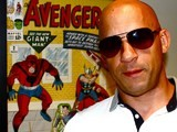 Vin Diesel standing in front of a Marvel poster (640x480)