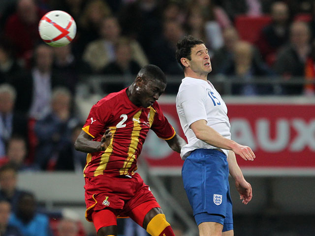Ghana's Daniel Opare jumps for the ball alongside England's Matthew Jarvis during a friendly match on March 29, 2013