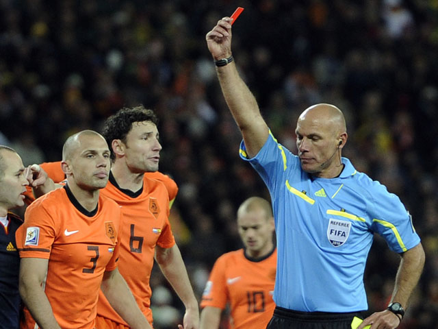 Referee Howard Webb of England shows the red card to Netherlands' John Heitinga during the World Cup final against Spain on July 11, 2010