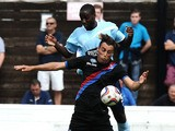 Dagenham & Redbridge's Brian Saah challenges Crystal Palace's Athula Nuhui during a friendly match on July 20, 2013