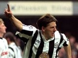 Peter Beardsley celebrates scoring against Queens Park Rangers.