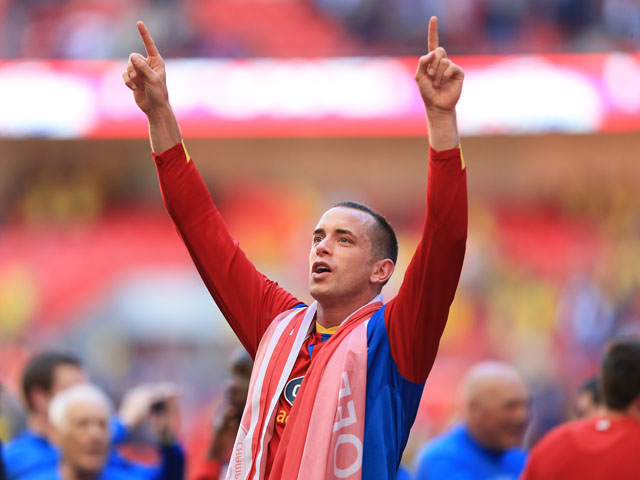 Crystal Palace's Aaron Wilbraham salutes the fans after the play off final on May 27, 2013