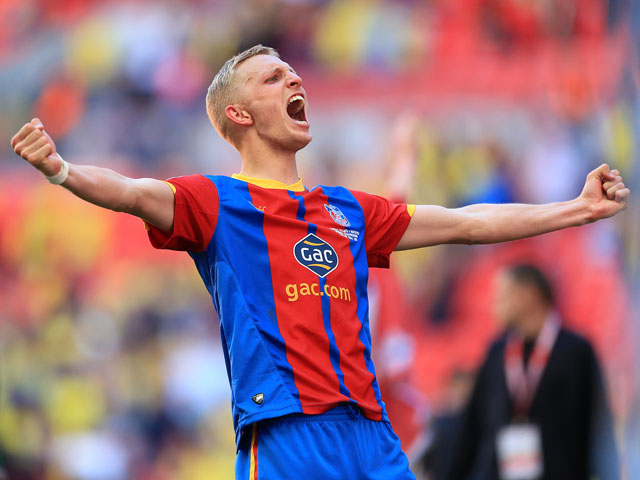 Crystal Palace's Dean Moxey celebrates winning the npower Football League Championship play off final on May 27, 2013