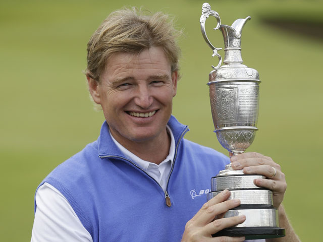 Ernie Els of South Africa holds the Claret Jug trophy after winning the British Open Golf Championship on July 22, 2012