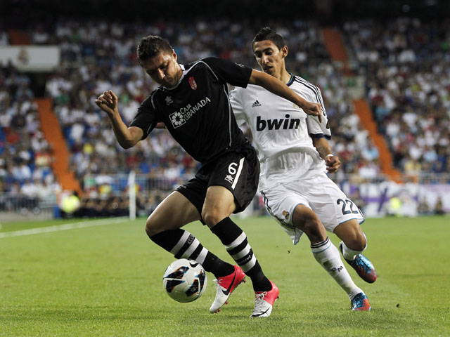 Granada's Guilherme Siqueira is pursued by Real Madrid's Angel Di Maria during the La Liga match on September 2, 2012