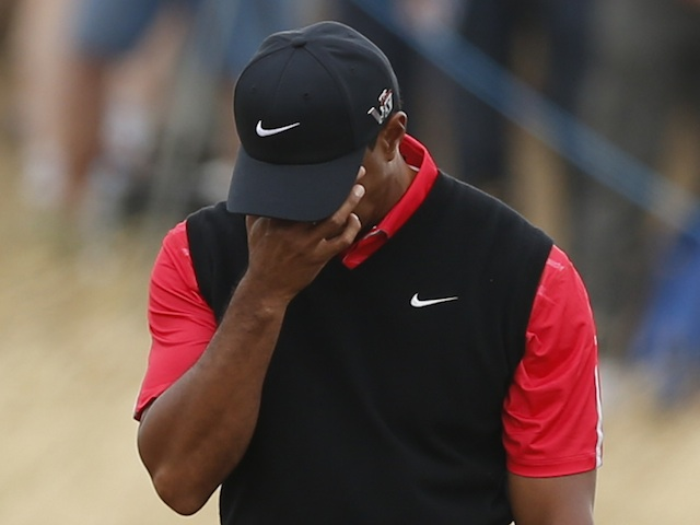 Tiger Woods reacts to a poor shot at the British Open on July 21, 2013
