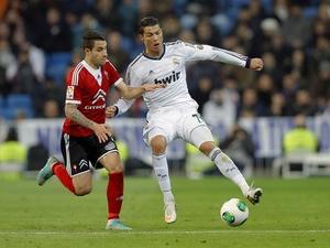 Celta de Vigo's Hugo Mallo tries to tackle Real Madrid's Cristiano Ronaldo during the La Liga clash on January 9, 2013