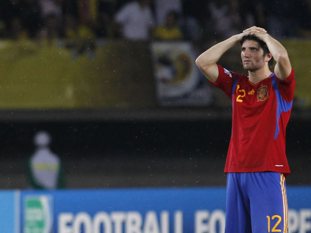 Spain's Carles Planas holds his head after losing against Brazil in a penalty shootout during the U-20 World Cup on August 14, 2011