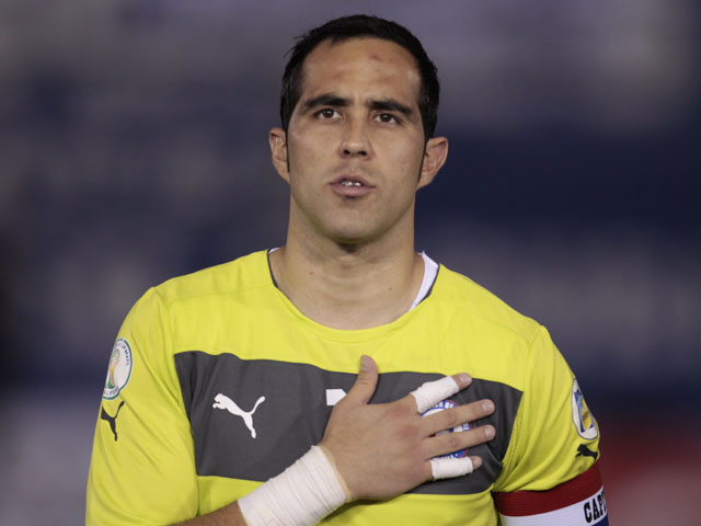 Chile goalkeeper Claudio Bravo stands during the playing of his country's national anthem before a 2014 World Cup qualifying soccer match against Paraguay on June 7, 2013