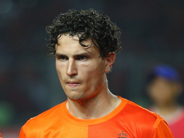 Holland's Daryl Janmaat lines up for a game with Indonesia on June 7, 2013