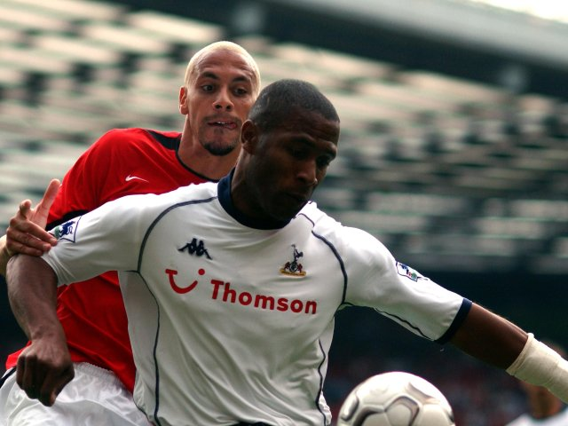 Les Ferdinand holds off a challenge from his nephew Rio Ferdinand.