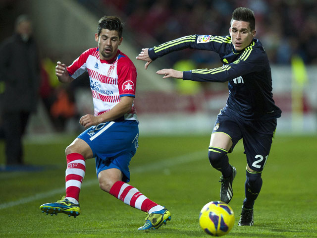 Granada's Nolito vies for the ball with Real Madrid's Jose Maria Callejon on February 2, 2013