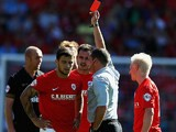 Barnsley's Dale Jennings is shown a red card during the second half against Wigan on August 3, 2013