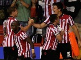 Sheffield United's Harry McGuire celebrates with teammates after a goal against Notts County on August 2, 2013