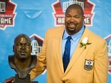 Dallas Cowboys' Larry Allen poses with his Hall of Fame bust during the NFL Class of 2013 Enshrinement Ceremony on August 3, 2013