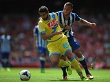 Porto's Nabil Ghilas and Napoli's Alessandro Gamberini battle for the ball during a friendly match on August 4, 2013