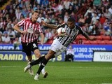 Notts County and Sheffield United players vie for the ball during their match on August 2, 2013