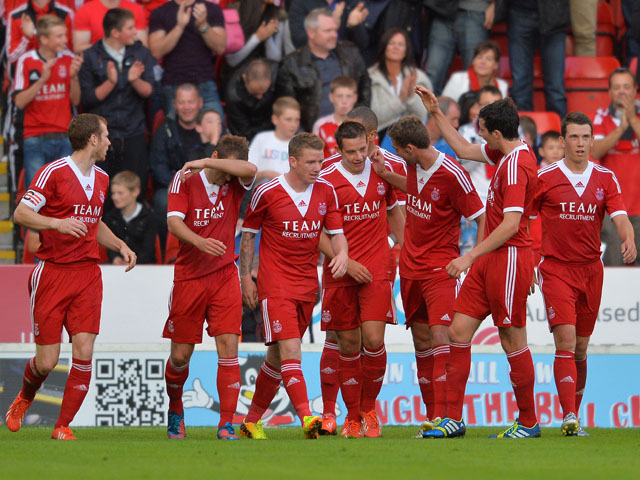 Peter Pawlett of Aberdeen celebrates his goal with his team-mates during the Pre Season Friendly match between Aberdeen and FC Twente on July 26 ,2013