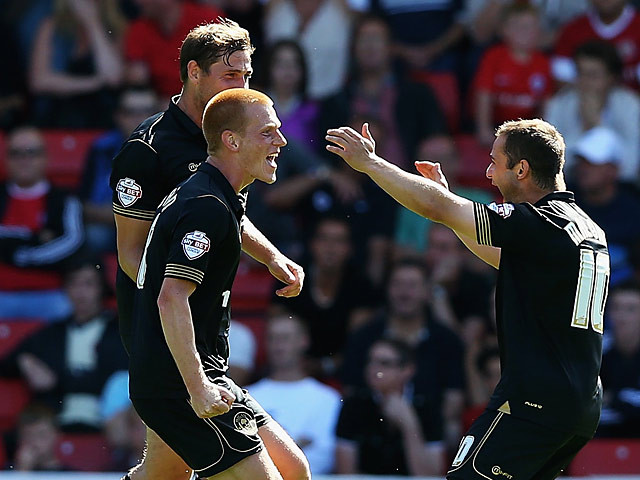 Wigan's Ben Watson is congratulated by team mate Shaun Maloney during the match against Barnsley on August 3, 2013